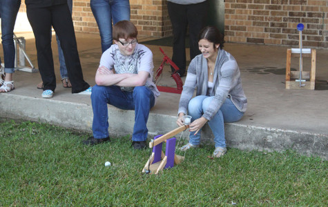 Students test out catapult project for Physics class
