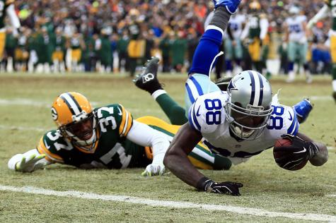 Dallas Cowboys wide receiver Dez Bryant catches the pass and falls just before the endzone.