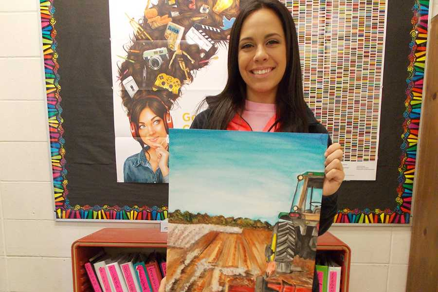 Senior+Kirty+Weatherly+shows+off+her+prize-winning+painting.+