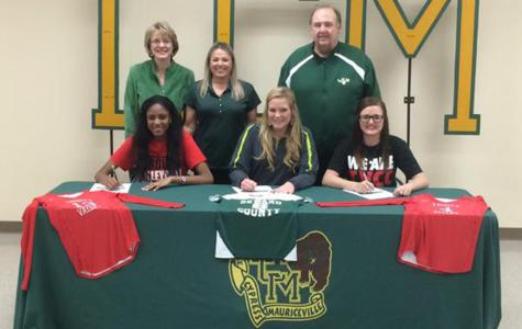 Volleyball players sign with colleges