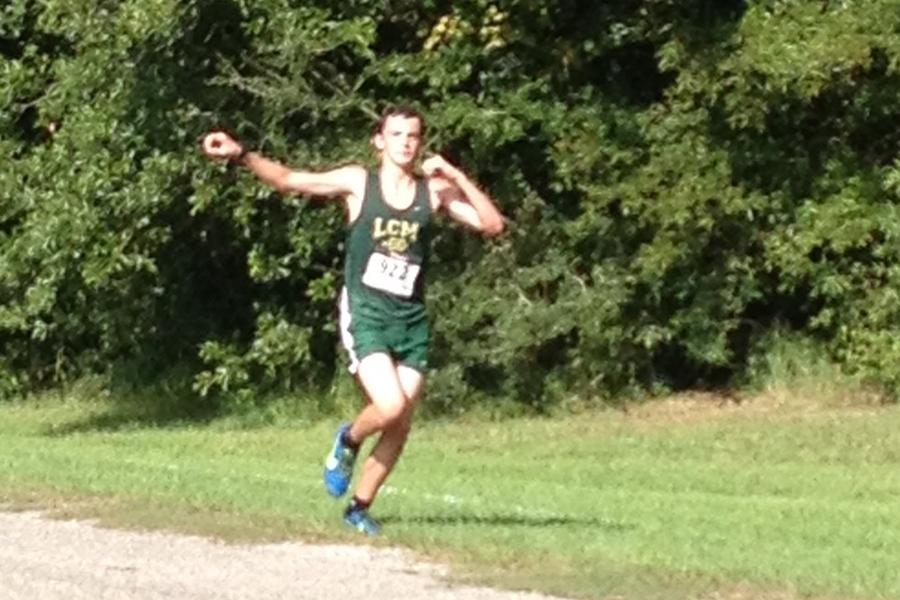 Peveto flexes for the shot, while he runs on a course at a meet.