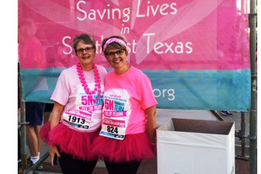 LCM Teacher Babs Foster and her sister, Penny, participate in the Color Run.