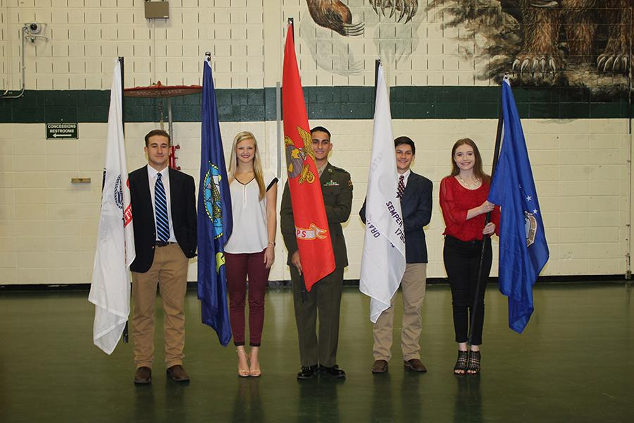 Student Council members presented the flags during the assembly.