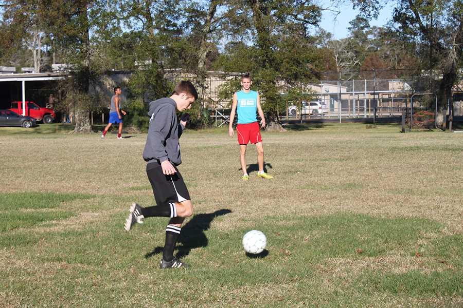 Senior captain Jacob Thomas practices during his athletics class.