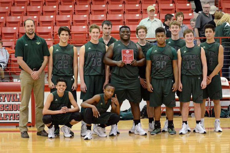 The JV team celebrates after winning the championship at the Deweyville Varsity Tournament.