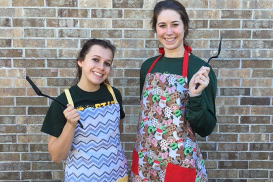 Kayla Dominguez and Maddie Frey show off their handmade aprons.