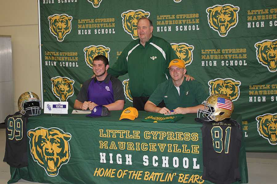 Stuart Viator and Mitchell Lee sign to play collegiate football.