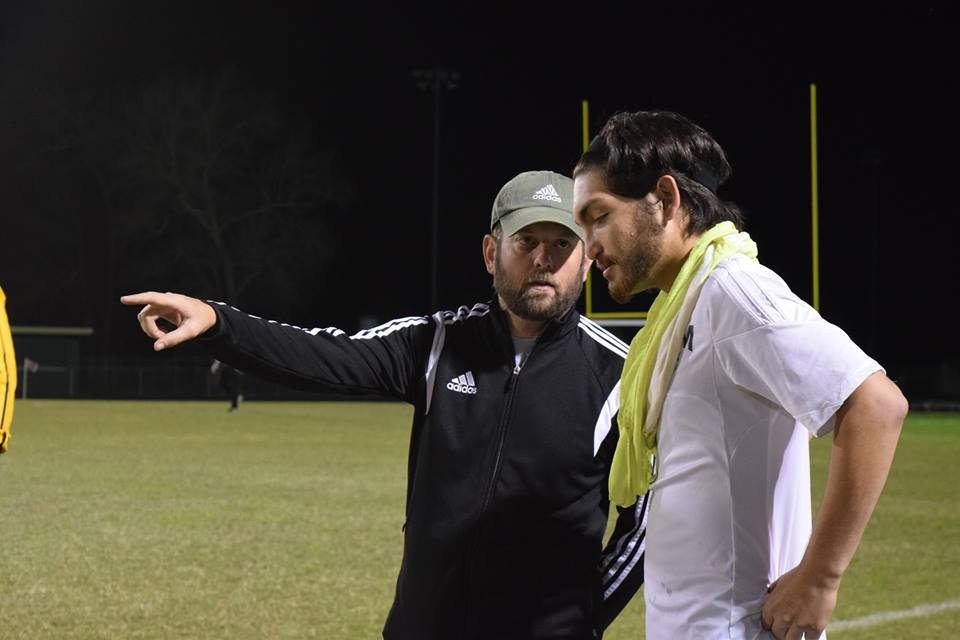 Head soccer coach Jeremy Watzlavik tells junior John Michael Gonzalez where to go on the field.