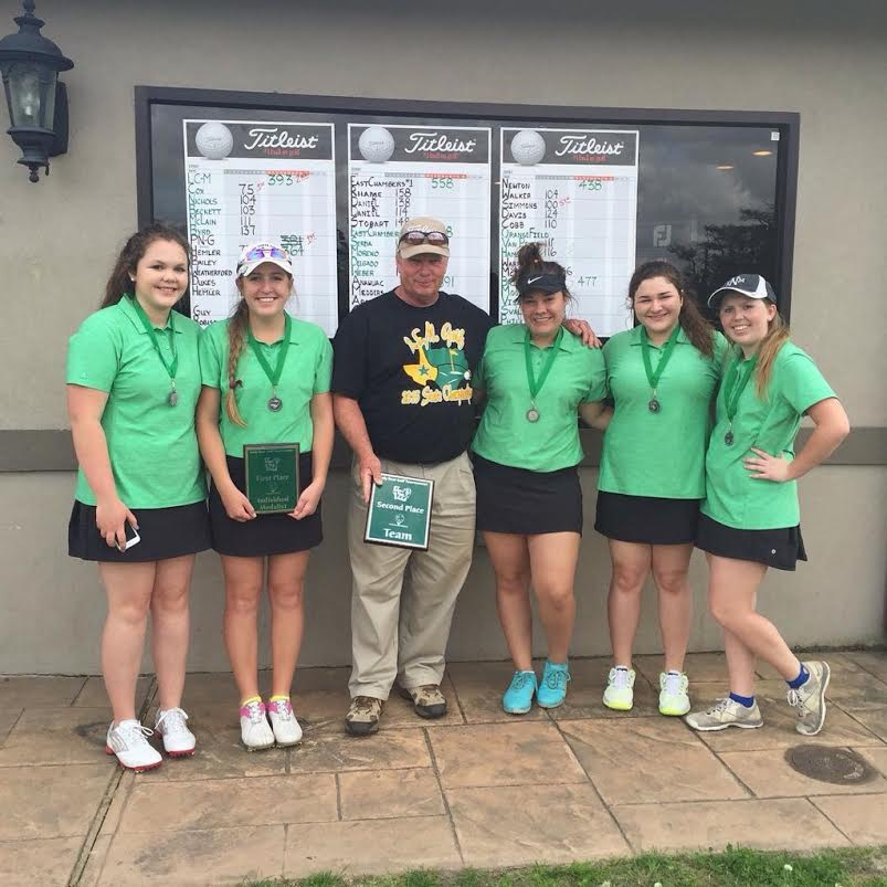The+girls+golf+team+stands+with+coach+Bart+Williams+and+their+medals+after+placing+second+at+a+tournament.