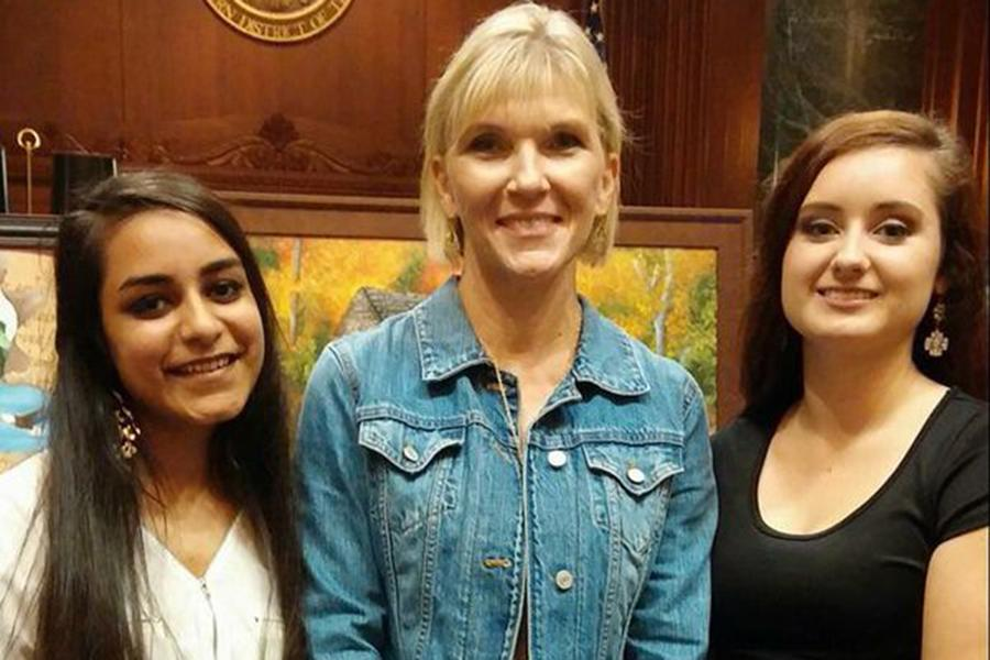 Seniors Sundas Imtiaz and Brooke Tant were honored at the Law Day Art Awards. They are pictured with art teacher Betsy Kaufman.
