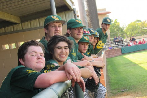 The sophomore baseball players cheer on their team.