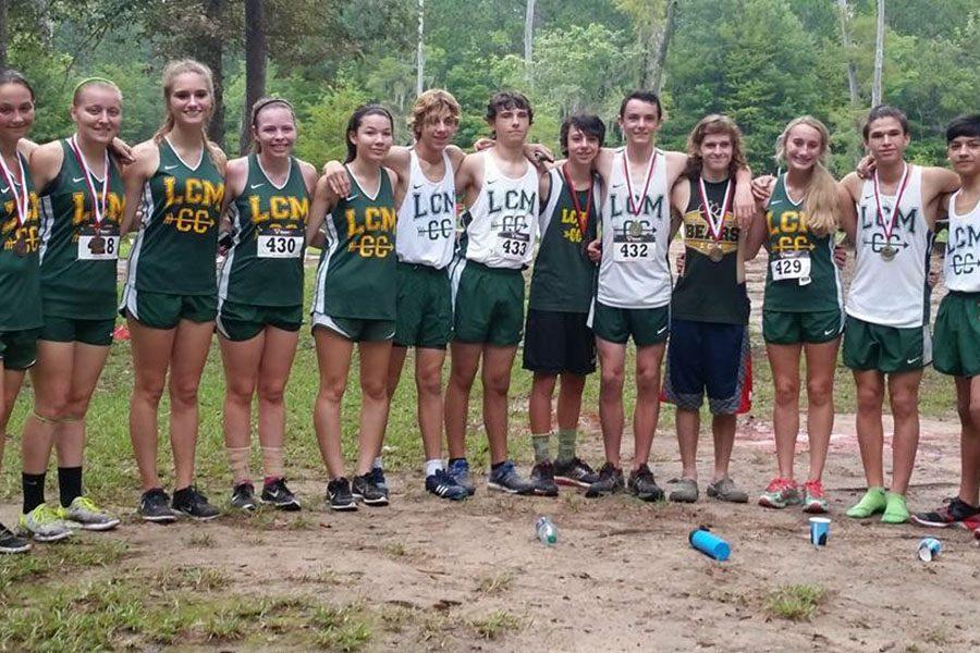 The+cross+country+team+takes+a+break+after+their+first+competition+at+Claiborne+Park.