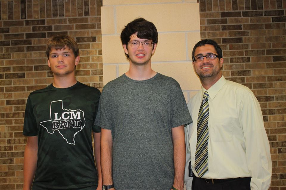 Matthew Cox and Thomas King received news of their award from principal Todd Loupe.