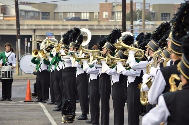 The musicians warm up in the Alamodome parking lot prior to their performance.