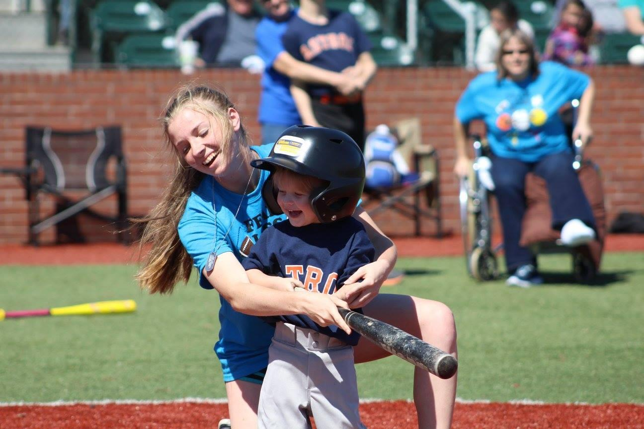 Junior Emily Landry helps Kyler Thayer swing the bat.