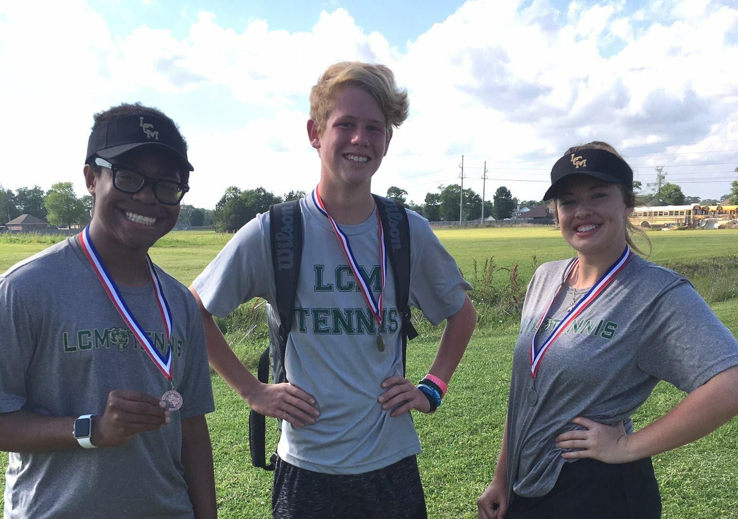 Dylan Chambers, Gavin Fountain, and Grace Walters receive medals at district.
