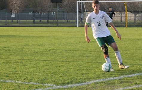 Boys soccer advances to playoffs