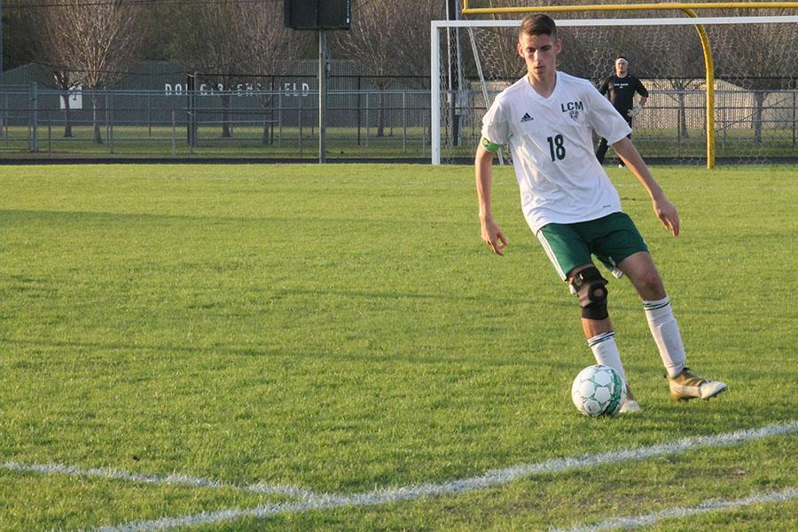 Junior Seth Brown works the ball down the field for the Bears.