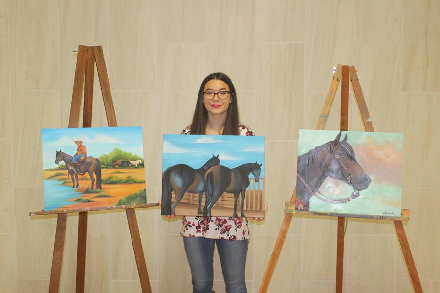 Olivia Keltz shows off some of her artwork.