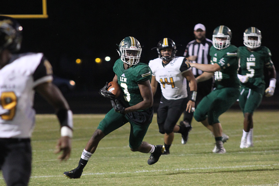 Senior Katon Brown runs the ball for the Bears against Woodville.