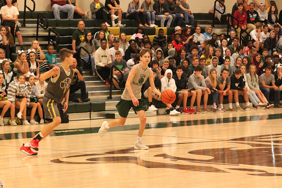Sophomore Scout Denman and junior Braden Bridges scrimmage during the first annual Midnight Madness last week.