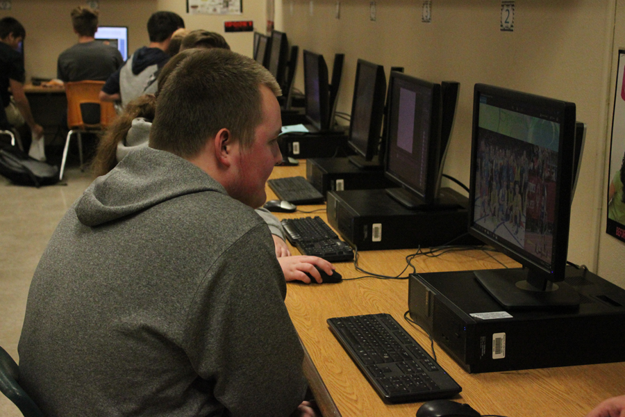 Junior Mason Coppage contently works in his graphic design class.
