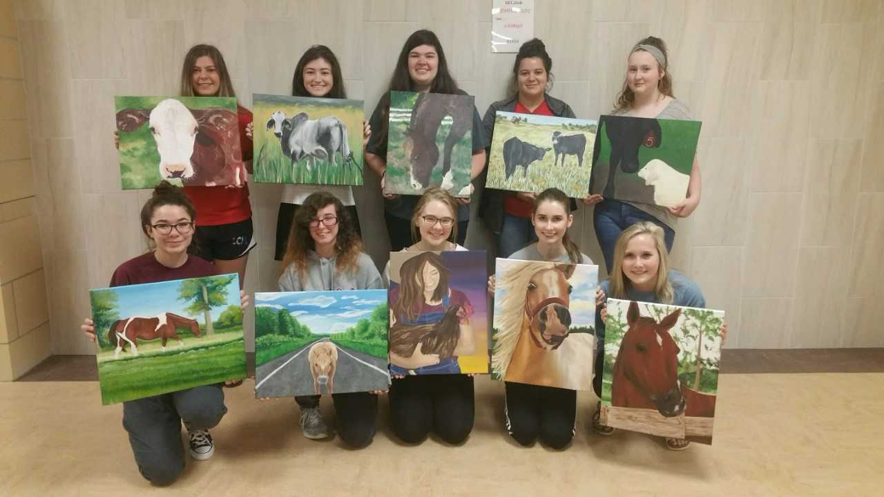 Students show off their pieces that were selected for the Houston Livestock Show and Rodeo contest.