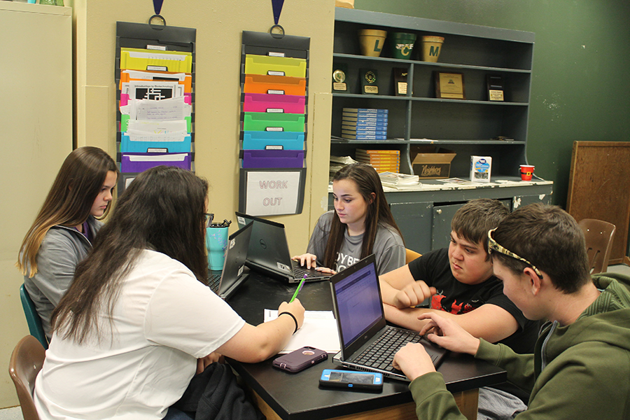 Students in Sarah Trammell's class work on a bio-tech project.