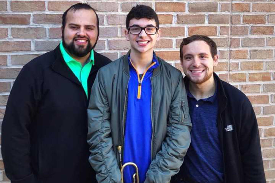 Assistant band director Justin Hargraves (right) and band director Jose Ochoa (left) helped senior Tommy Holland earn a spot in the 5A TMEA All Symphonic Band.