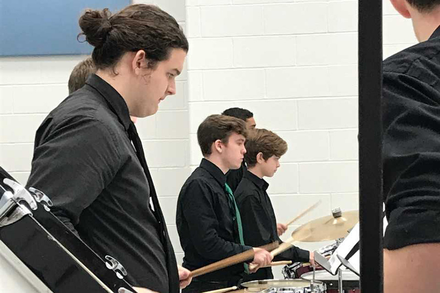 Percussionists practice their piece for solo and ensemble.