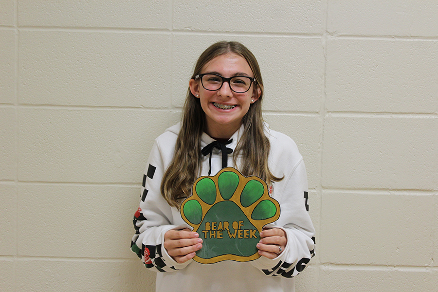 Stella Hughes is a freshman who always has a book in her hands and a smile on her face.