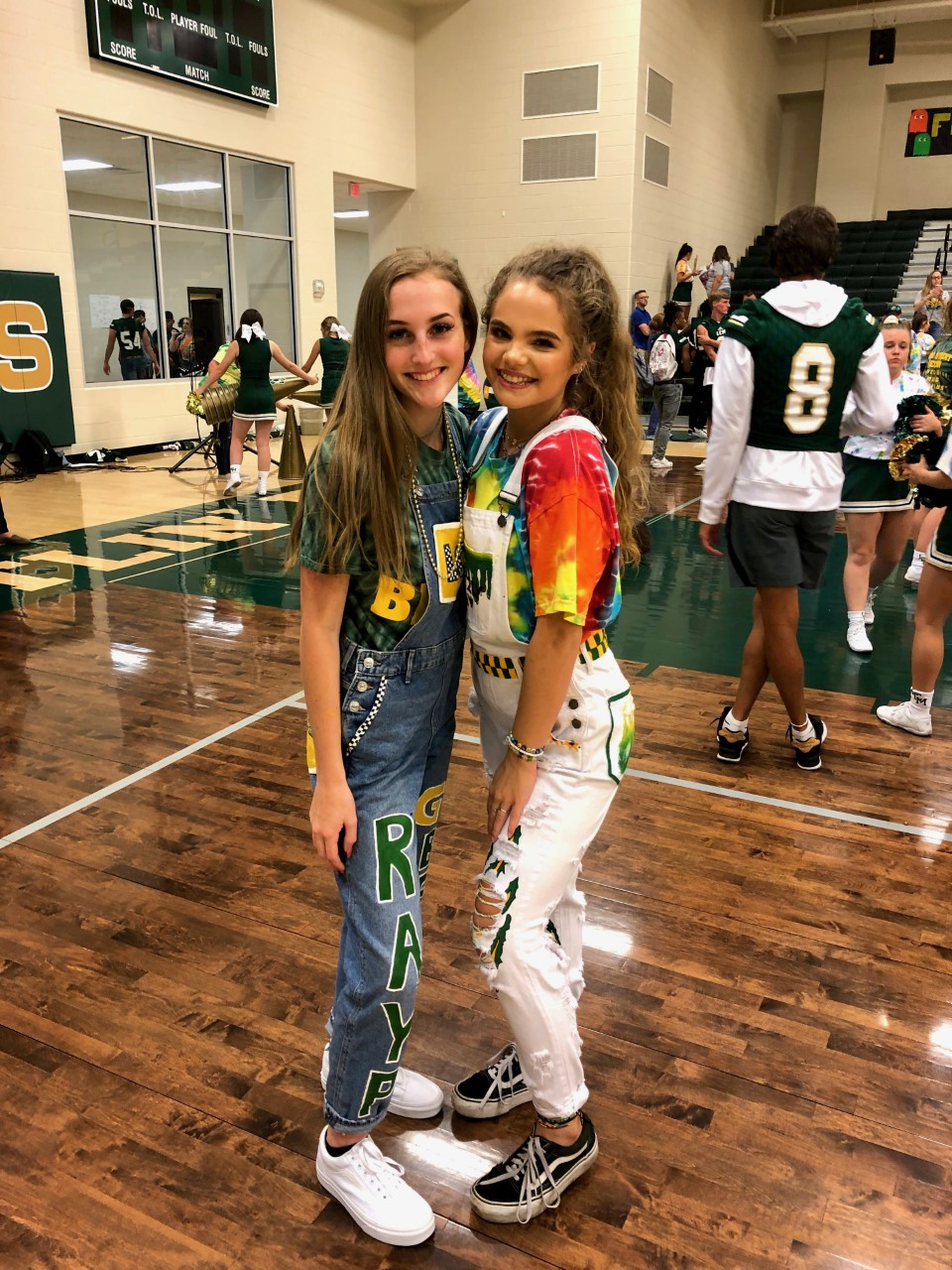 Junior Rayvyn Peveto (left) has used her artistic skills to make spirit overalls for many students, including Bear Facts staff writer Jadyn Stack (right).