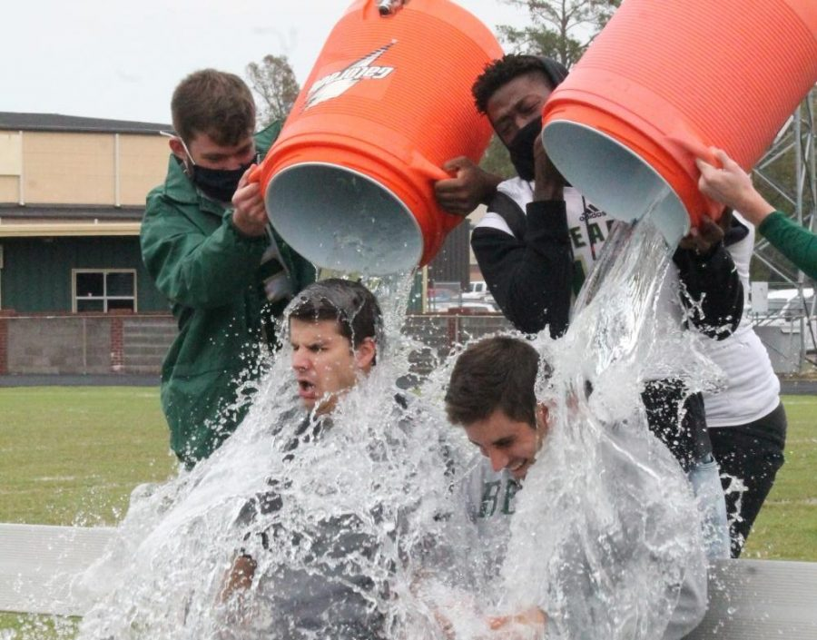 Principal Ryan DuBose and coach Hunter Gonzales get drenched in the Ice Bucket Challenge.