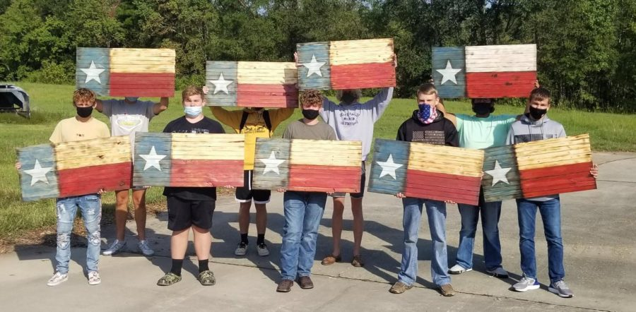 The woodshop classes are currently making and selling wooden flags.