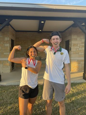 Senior Lizzy De La Fuente and junior Evan Barborek win the first tournament of the season.