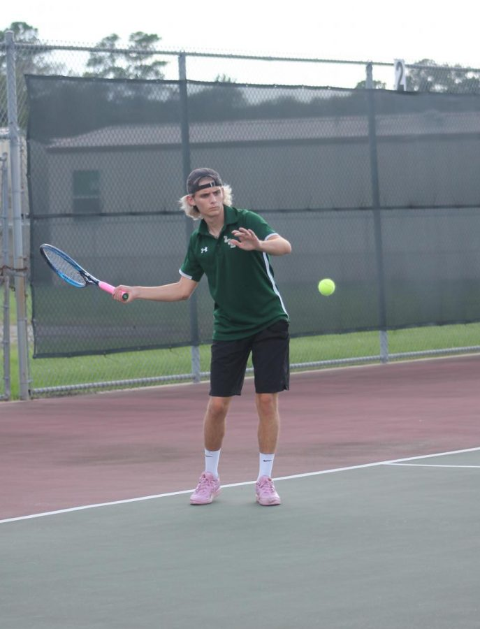 Senior Dax Rodgers and the rest of the tennis team are gearing up for playoffs after winning district.